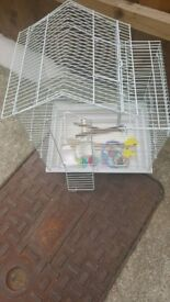 Small bird cage with lots of extra stuff
