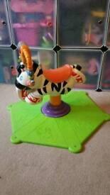 Fisher-Price spin zebra bancer.