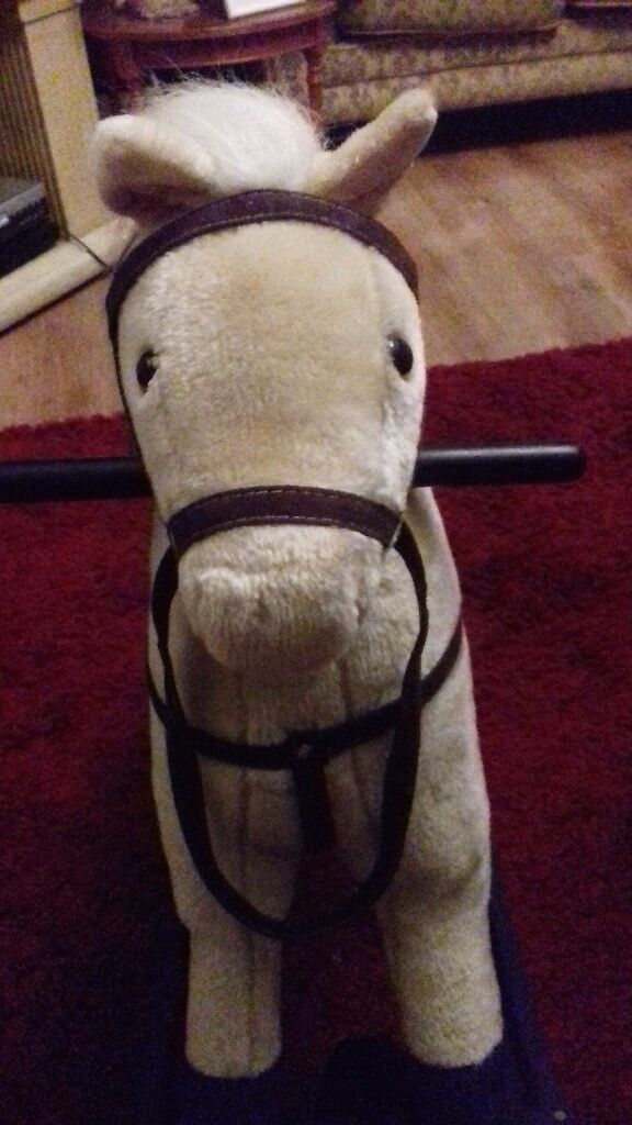 Rocking horse used but still in fab condition. Press the ear and it 'neighs and clip clops'