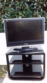 Panasonic Viera 26 Inch Black Flat Screen Television + Black double shelved glass TV Stand