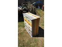 Stunning pine chest of drawers in a light wash multi colour style with beautoful draw liners. 6 draw