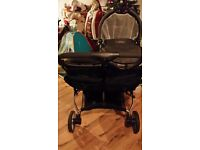 Double buggy with carrycot and carseat fits through interior doors