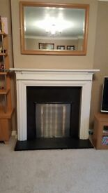 Gas fire with mantle and hearth