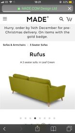 Made mid-century green sofa