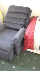 Blue riser recliner chair in immaculate condition