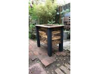 Chunky garden planter from reclaimed timber flame treated and painted plu
