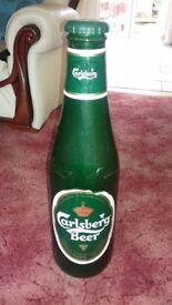 carlsberg plastic money bottle