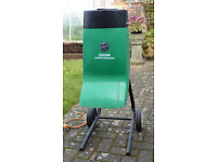 2000W garden chipper/shredder designed to shred plant waste, twigs, brush & small branches