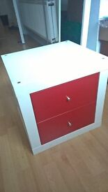 White Ikea Kallax unit with red drawers - Excellent condition!