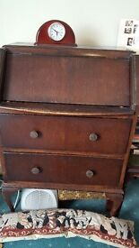 Small old dark wood bureau with pull out ledge which lifts top.