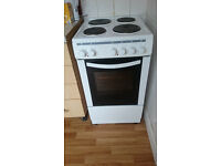 White Oven. Electric with 4 hobs and single standard oven.