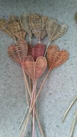 Wicker weaved heart stands