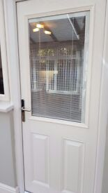 Composite door. White and glass with integral venetian blind.