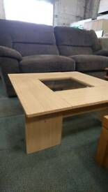 Coffee table with centre glass panel