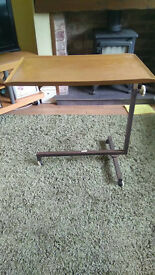 Over bed table with tilting top
