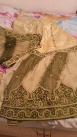 TWO BRIDAL OUTFITS FOR SALE. RED ONE WORN ONCE £400 ONO. GREEN & CREAM ONE BRAND NEW £300 ONO