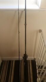 2 fishing rods 1 reel for sale with landing net