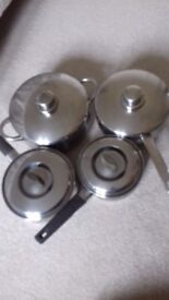 4 stainless steel saucepans various sizes