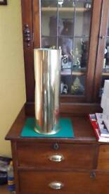 Brass shell empty 18inch tall 4 inches cut of top 1 slight dent
