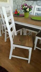 White and antique pine chairs dining room