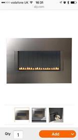 Gas fire - cascara flueless on the wall.