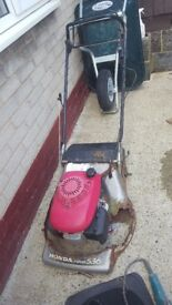 honda lawn mower enging still perfect selling as spares and repairs as bodywork has gone