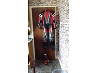 ladies ixs 2 piece leathers red black size 12/38 with size 3 boots .boots never worn suit twice.