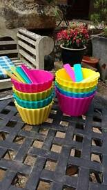 2 sets of multi coloured bowls ans spoons