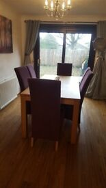 Oak style dining table with 6 purple chairs