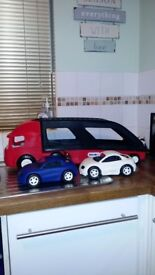 Little tikes car transporter and two cars