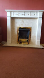 Gas fire with marble hearth and surround fireplace