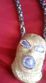 Zakaveli iced out chains & designers