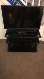 Toshiba flatscreen TV 32inch and glass tv stand