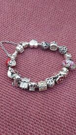 Genuine Pandora bracelet with 15 charms and security chain