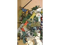 Lot of various plastic figures and three diecast field guns by britains and crescent.