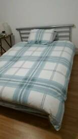 Metal bed frame and double mattress