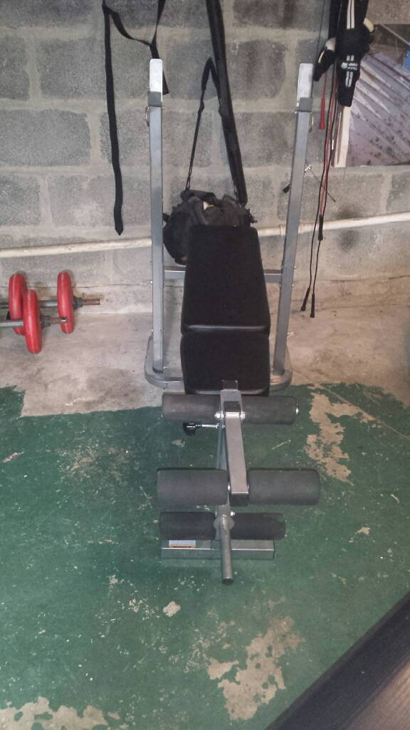 Weights bench with leg extensions
