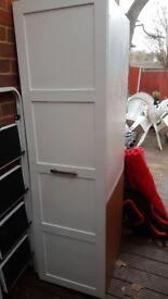 Tall white kitchen larder