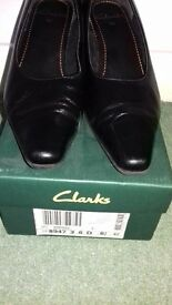 Never worn black low heel shoes