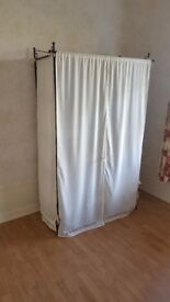 Hanging Wardrobe. Black Steel Frame, with white curtain covers. 4 interior shelves plus solid top.