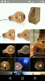 Laser cut wooden lightbulb shaped light pendants