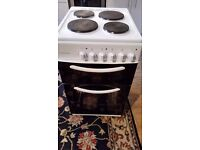 Freestanding white electric cooker