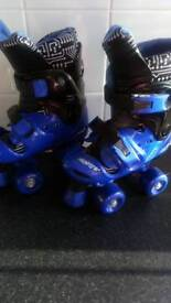 Brand new adjustable sized roller boots