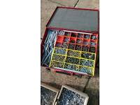 Various screws, nails and other bits with metal storage box