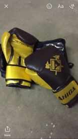 Brand new Ahiga boxing gloves 14oz in maroon and gold.