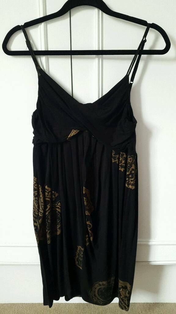 Womens Black short dress, Size Min Surbiton, LondonGumtree - Womens short black dress with gold print. Size M. 100% Cotton.Buyer pays for postage (£3.00). No returns accepted
