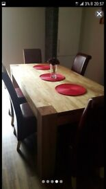Solid oak large dining table with six chairs next to new ex cond