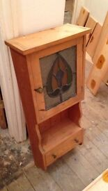 Handmade cabinet with stained glass window