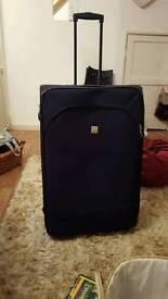 Large suitcase on wheels