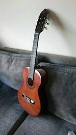 Guitar 34 inches long with travel bag in good conditions